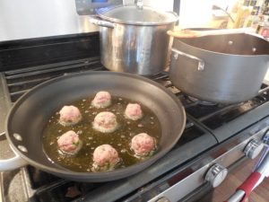 Fry Italian meatballs in olive oil