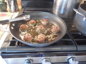 Italian meatballs turned in olive oil