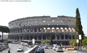 Drive Italy! Cars and buses along the Coloseum in Rome