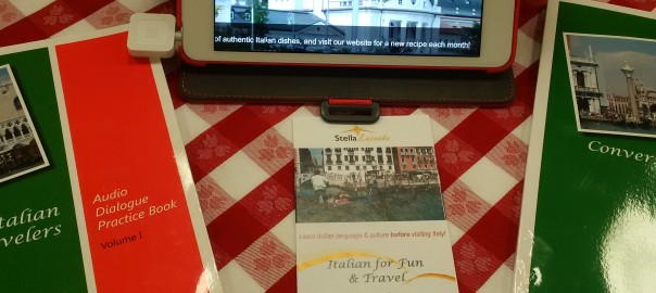 Conversational Italian for Travelers books on a red checkered table cloth with ipad set to the learntravelitalian blog.