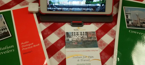 Conversational Italian for travelers books and website on an ipad on a red checkered table cloth