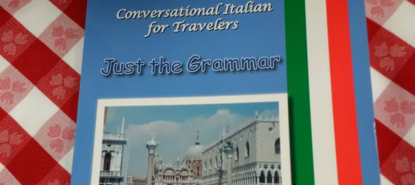 Picture of Conversational Italian for Travelers Grammar book on a checkered table cloth, reference book with a chapter on how to make comparisons in Italian