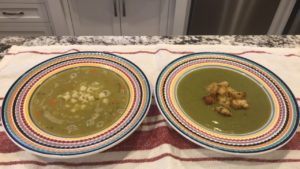 Two bowls of split pea soup. The bowl on the left has ditalini pasta and the bowl on the right is garnished with croutons.